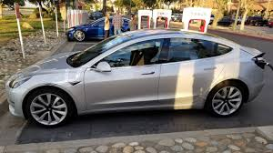 undisguised tesla model 3 spotted at california supercharger the