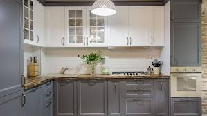 how do you clean kitchen cabinets without removing the finish how to paint kitchen cabinets without sanding this house