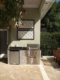 small outdoor kitchen patio mediterranean with archway beach