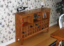 wine buffet made from an old church pew by grapevine