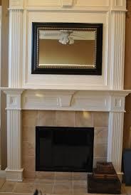white fireplace surround boasts black marble mantel hgtv fire