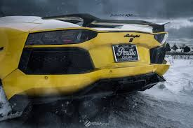 yellow lamborghini aventador yellow lamborghini aventador enough to melt snow on adv 1 wheels