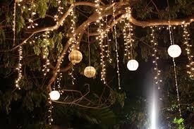capiz lanterns hanging on the tree wedding