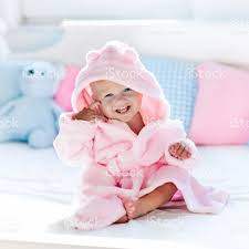 baby in bathrobe or towel after bath stock photo 647438102 istock