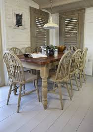 rustic shabby chic dining table with 8 wheelback chairs by the