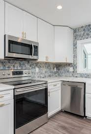 what tile goes with white cabinets white cabinets with colorful backsplash backsplash kitchen