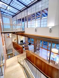 photos hgtv contemporary stairwell with glass railing and balcony