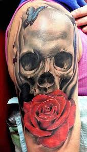 skull tattoos with roses meaning binge thinking