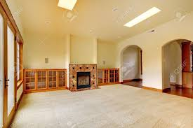 large empty room with fireplace and shelves new luxury home