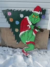 The Grinch I so want to make this and put it on the side of our