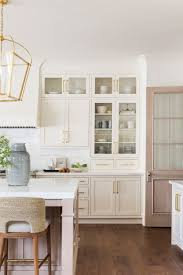 antique white kitchen cabinets brass touch of brass the brass hardware trend is still going strong