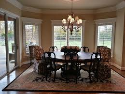plantation shutters on a bay styled window in a dining area jpg