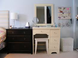 bathroom black makeup vanities with table lamp and mirrored