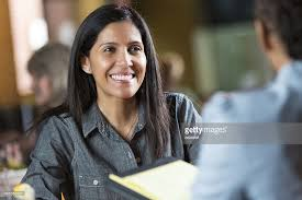 hispanic woman with resume applying for job during interview