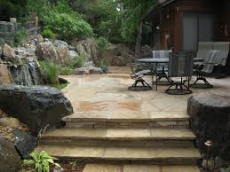 Stone Patio Images by Flagstone Patio And Stairs With Boulders And Naturalistic Water