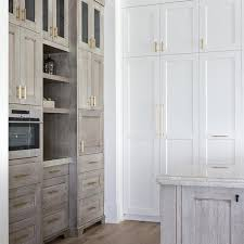 are two tone cabinets out of style design trend 2018 two toned kitchens becki owens