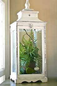 love the use of the distressed lantern and simple fern gonna do