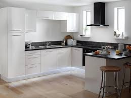 white wall mounted cabinet kitchens with black appliances and