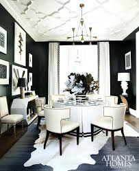 black table white chairs black dining room design by interiors photographed table with white
