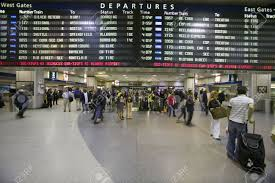 Penn Station Amtrak Map amtrak train travelers stand in line under departures sign at