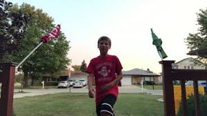 kid wins backyard football game by odelling a interception pick