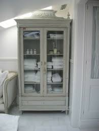 gorgeous bathroom linen cabinet from a modern farmhouse by h2