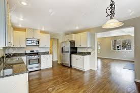 Kitchen And Living Room Open Floor Plans Open Floor Plan White Kitchen Room With Steel Appliances View