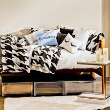 turn your bed into a daybed to make it more comfortable for