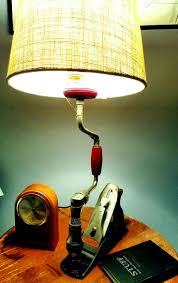 354 best upcycled lighting images on pinterest lamp made from an old stanley wood plane and old hand drill brace
