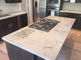 white travertine concrete counter top kitchen island