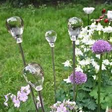 blown glass garden ornament birdbath birdfeeder glassplate