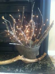antique coal bucket filled with branches u0026 twig lights for display