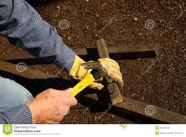 hammering wood pieces for trellis stock photo image 46728346