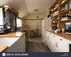 belfast sink in traditional galley kitchen with cream fitted units