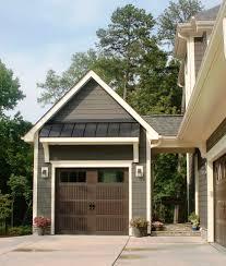 detached garage with wood overhead garage door garage modern and