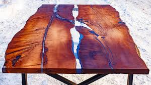 live edge river table epoxy this live edge dining table uses epoxy resin to mimic flowing river