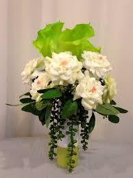 artificial rose and calla lily arrangement in ceramic vase cream