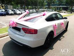 white and pink audi white audi s5 wedding car decorations by ace drive car rental