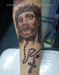 amazing jesus face with rosary cross tattoo on forearm by ray