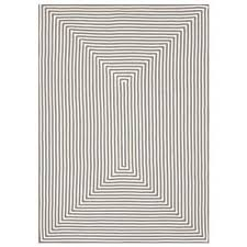 Geometric Outdoor Rug And White Braided Indoor And Outdoor Rug