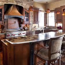 gorgeous tuscan colored stove hood in this custom kitchen jm