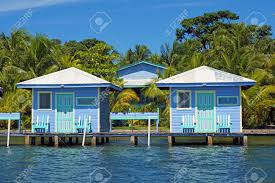 overwater bungalows with palm trees in background bocas del