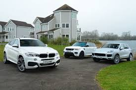 land rover jeep 2014 bmw x6 vs range rover sport and porsche cayenne auto express