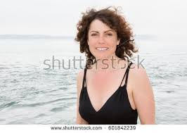curly hair for 40 year woman 40 year old curly hair stock photo 601842239 shutterstock