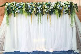 wedding backdrop of flowers beautiful backdrop flowers white fabric ready for wedding