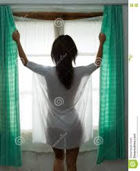 opening curtains in lingerie stock photo image 72389501