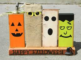 primitive halloween decoration with wooden monsters pumpkin