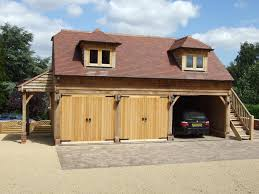 oak country buildings with big wood garage kits and red tuscany