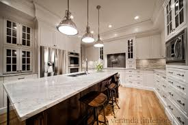 River White Granite Countertops | custom painted kitchen with oak island