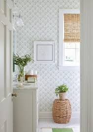 sister parish white and green bathroom with sister parish chou chou wallpaper